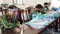 Làm hàng ngàn mũ chắn giọt bắn tặng hai tỉnh Salavan và Sekong (Lào)