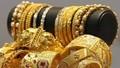 Giá vàng tăng nhẹ trở lại nhưng chịu sức ép của USD