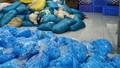 Phát hiện kho chứa hàng chục tấn găng tay cao su nhăn nhúm, bẩn thỉu