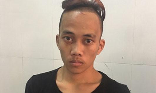 Đối tượng Nguyễn Tiến Trình tại cơ quan điều tra.