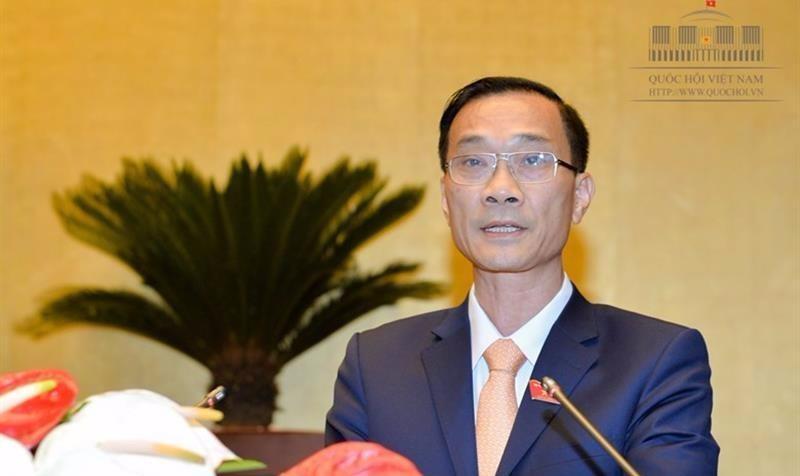 Chủ nhiệm Ủy ban Kinh tế Vũ Hồng Thanh trình bày báo cáo thẩm tra