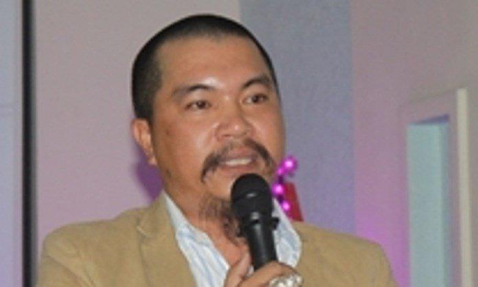 Đối tượng Nguyễn Hữu Tiến tại một buổi hội thảo