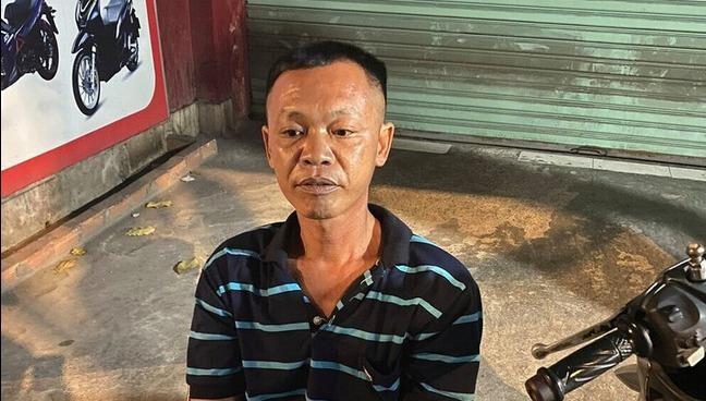 Bị can Nguyễn Quốc Lâm .