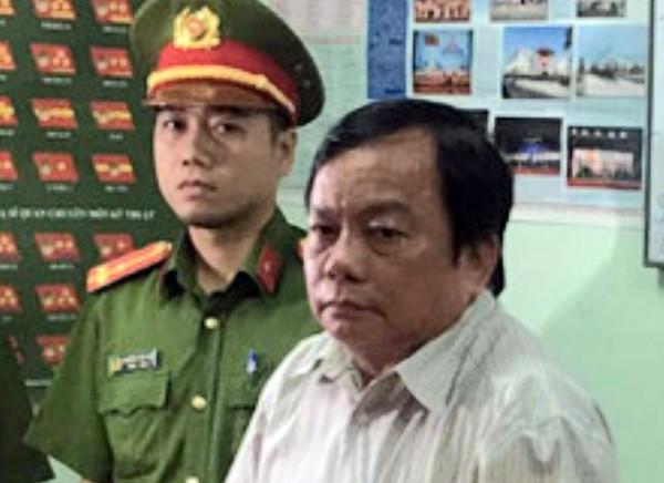 Ông Trần Hoàng Khôi lúc bị bắt. Ảnh CAND