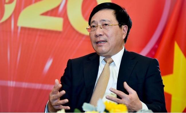 Ủy viên Bộ Chính trị, Phó Thủ tướng, Bộ trưởng Ngoại giao Phạm Bình Minh trả lời phỏng vấn báo chí