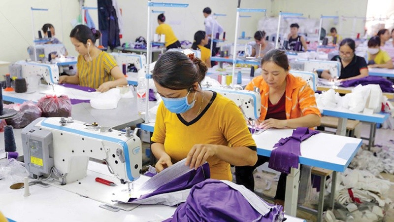 Cơ sở may Văn Chinh (xã Quang Minh, huyện Hiệp Hòa, tỉnh Bắc Giang) vay vốn ưu đãi của Chính phủ từ chương trình giải quyết việc làm thực hiện qua Ngân hàng Chính sách xã hội