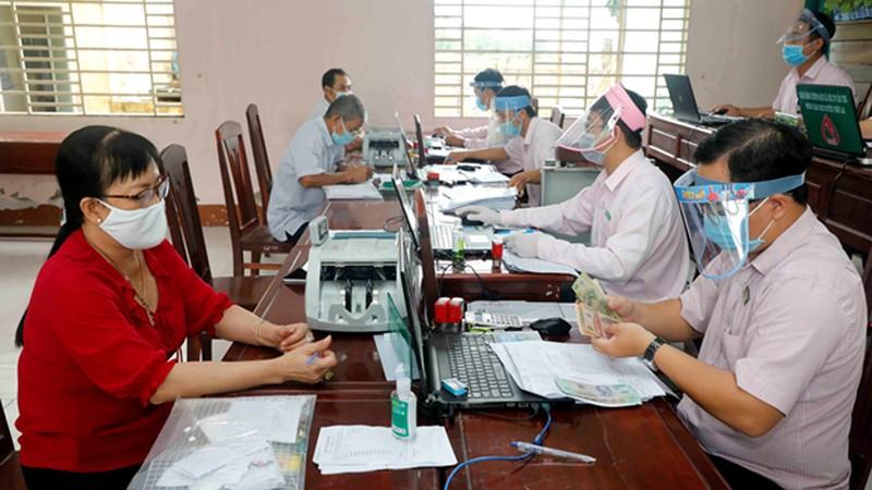 Một buổi giao dịch cho vay tại điểm giao dịch xã Thới Thạnh, huyện Thới Lai, TP. Cần Thơ. (Ảnh: Trần Việt)