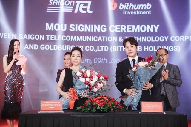 Bà Nguyễn Cẩm Phương, TGĐ SAIGONTEL và ông Kim Moo Joong, đại diện Bithumb Holdings tại Việt Nam