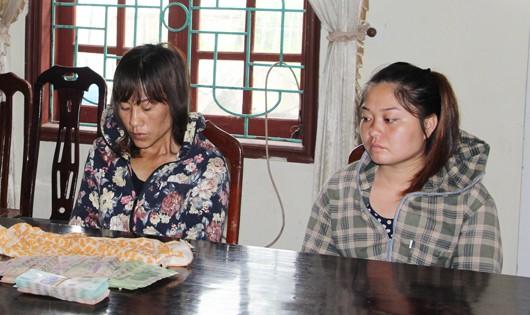 Vi Thị Nghiệp và Lê Thị Toàn tại CQĐT cùng tang vật