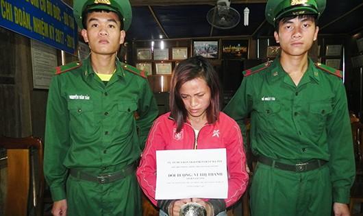 Vi Thị Thanh mua gần 1kg thuốc phiện đối tượng người Lào về bán kiếm lời thì bị bắt.