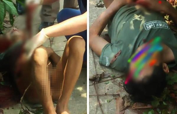 Hình ảnh người đàn ông nằm bên vệ đường, tự dùng dao đâm bụng mình
