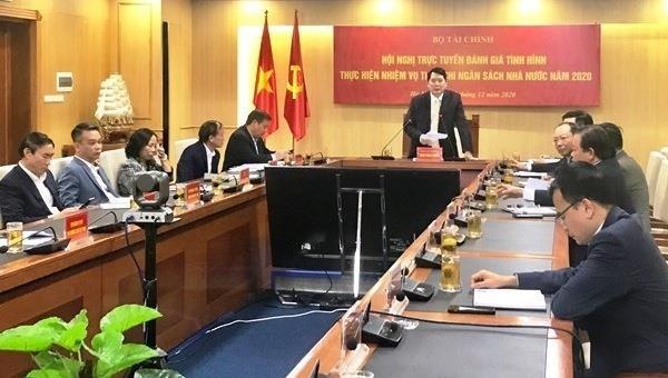 Tổng cục trưởng Tổng cục Thuế Cao Anh Tuấn báo cáo tại Hội nghị trực tuyến đánh giá tình hình thực hiện nhiệm vụ thu-chi NSNN năm 2020.