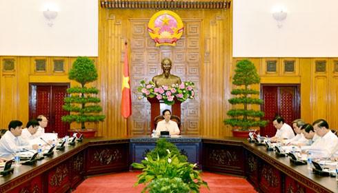 Thủ tướng Nguyễn Tấn Dũng chủ trì cuộc họp với các Ban, Bộ ngành, cơ quan liên quan về việc đồng Nhân dân tệ của Trung Quốc giảm giá. Ảnh: VGP/Nhật Bắc