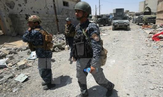 Lực lượng Iraq tuần tra tại Mosul. (Ảnh: AFP/TTXVN)