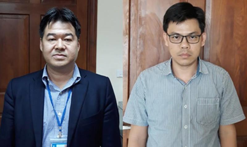 Bị can Nguyễn Hoài Giang (trái) và bị can Phạm Xuân Quang (phải).