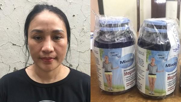 Nguyễn Thị Thu Huyền và tang vật vụ án.