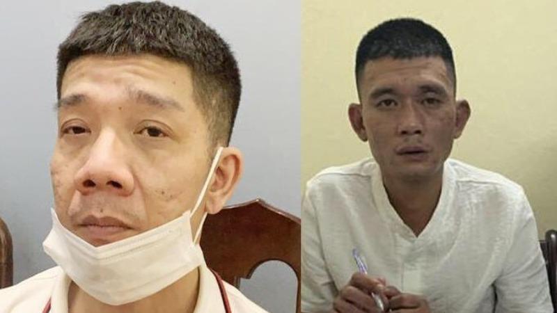 Phạm Anh Tuấn (trái) và  Dương Thanh Tùng tại cơ quan Công an.
