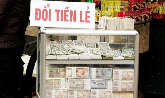 Hành vi đổi tiền lẻ trái pháp luật có thể bị phạt tới 40 triệu đồng -Ảnh minh họa.