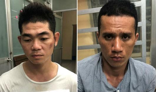 Huỳnh Vỹ Minh (trái) và Trần Huỳnh Huấn tại cơ quan điều tra