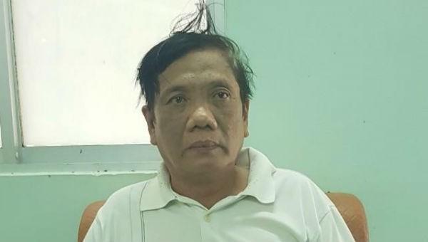 Nguyễn Văn Mết tại cơ quan công an