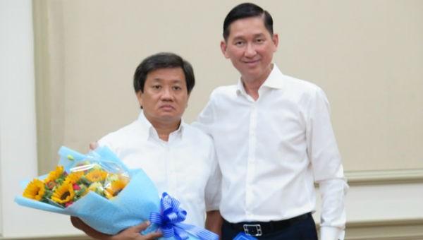 Ông Đoàn Ngọc Hải (trái) từ chức sau vài giờ được phân công nhiệm vụ mới