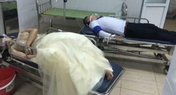 Bức ảnh cặp đôi tự tử được đưa vào bệnh viện cấp cứu trong trang phục cô dâu, chú rể được chia sẻ trên mạng.