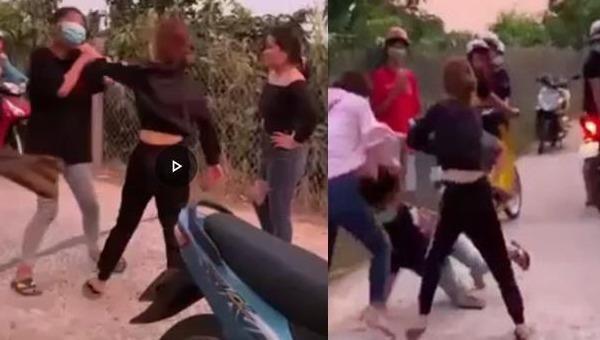 Nữ sinh M bị nhóm người vây đánh. Ảnh cắt từ clip.