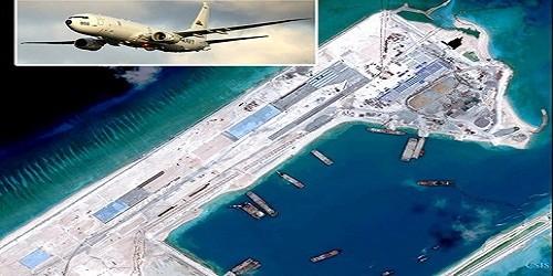 Máy bay trinh sát P-8A Poseidon của Hải quân Mỹ đã bị Trung Quốc 8 lần cảnh báo xua đuổi khi bay gần Đá Chữ Thập ngày 20.5, nơi Trung Quốc đang xây đảo nhân tạo phi pháp - Ảnh: Reuters/CSIS.