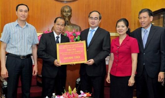 Lào ủng hộ Việt Nam 257.000 USD khắc phục hậu quả thiên tai