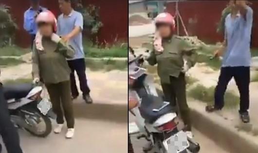 Người dân vây bắt người phụ nữ đi xe máy vì nghi bắt cóc trẻ em (Ảnh cắt từ clip)