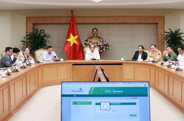 Bộ trưởng, Chủ nhiệm Văn phòng Chính phủ Mai Tiến Dũng chủ trì buổi họp đánh giá. Ảnh: TTXVN