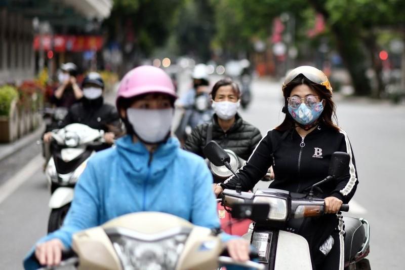 Việt Nam đã giảm bớt giãn cách trên toàn quốc từ 23/4. Ảnh: AFP