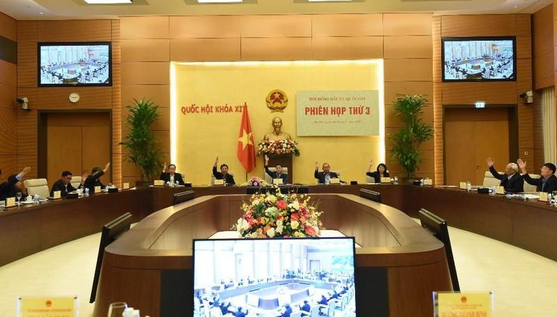 Hội đồng Bầu cử quốc gia biểu quyết. Ảnh: VGP/Nguyễn Hoàng