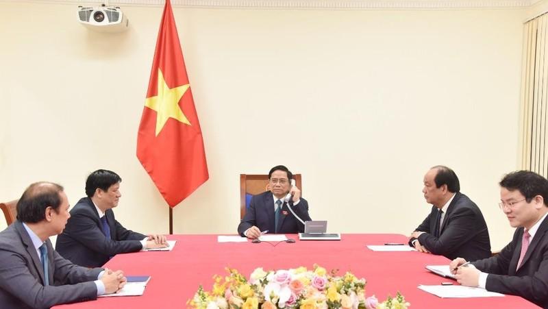 Thủ tướng Phạm Minh Chính điện đàm với Thủ tướng Lào Phankham Viphavanh. Ảnh: VGP/Quang Hiếu