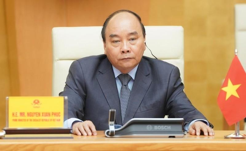 Thủ tướng Nguyễn Xuân Phúc dự Hội nghị Thượng đỉnh trực tuyến G20 ứng phó COVID-19. Ảnh: VGP/Quang Hiếu.