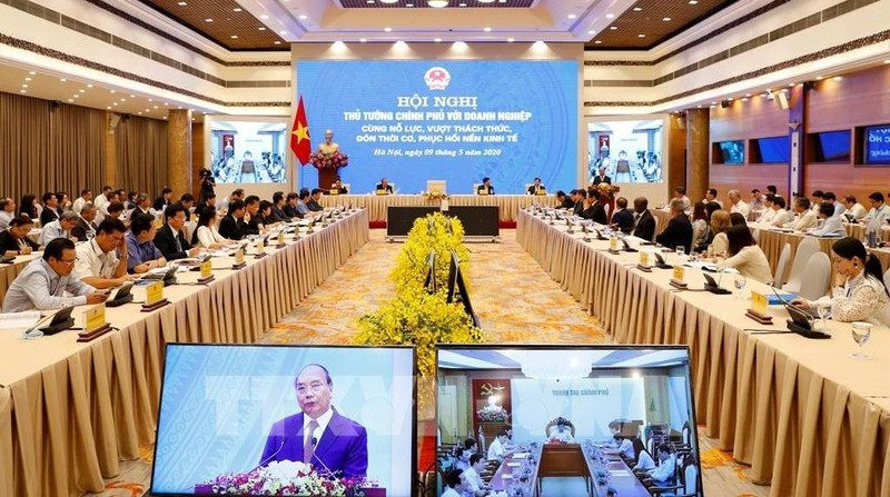 Thủ tướng Nguyễn Xuân Phúc chủ trì Hội nghị trực tuyến Thủ tướng Chính phủ với doanh nghiệp. Ảnh: Thống Nhất – TTXVN