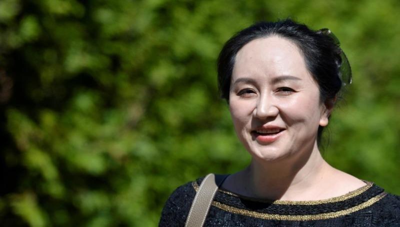 Giám đốc tài chính của Huawei Technologies Mạnh Vãn Châu rời nhà tới tòa án ở Vancouver, British Columbia, Canada ngày 27/5 vừa qua. Ảnh: Reuters