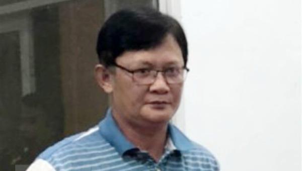 Bị can Huỳnh Hồng Bảo tại thời điểm bị bắt. (Ảnh: TTXVN phát)