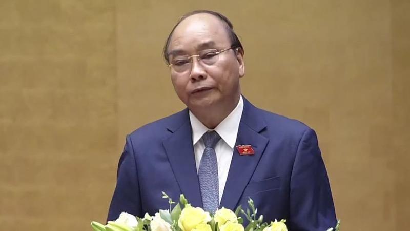 Thủ tướng Nguyễn Xuân Phúc báo cáo tại Kỳ họp thứ 9.