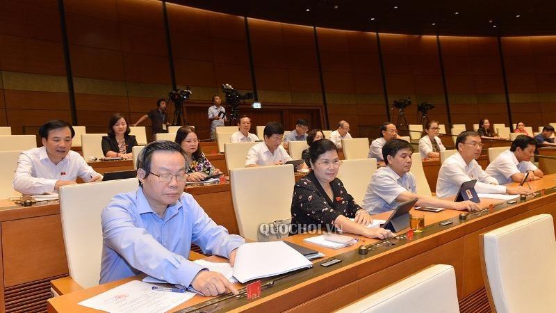 Các đại biểu Quốc hội bấm nút biểu quyết. (Ảnh minh họa)