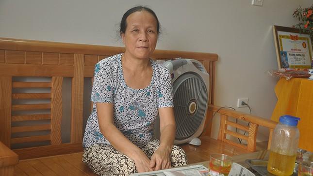Vợ ông Trần Xuân Sơn bị mất, bà Trần Thị Ngượi trao đổi với phóng viên.