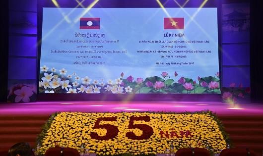 Hình ảnh tại Lễ kỷ niệm 55 năm thiết lập quan hệ ngoại giao Việt Nam - Lào được tổ chức tại Hà Nội.