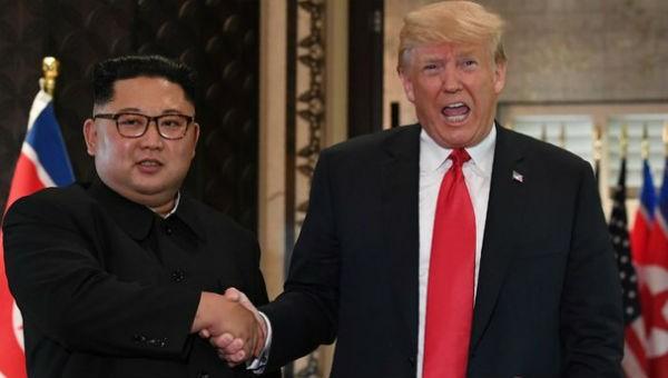 Ông Trump và ông Kim tại cuộc gặp lịch sử ở Singapore.