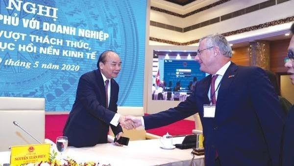 Thủ tướng Chính phủ Nguyễn Xuân Phúc và Chủ tịch EuroCham Audier.