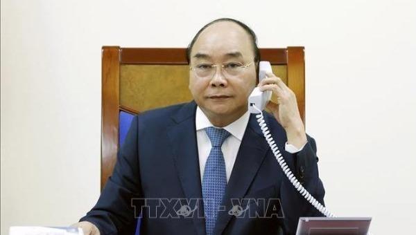 Thủ tướng Chính phủ Nguyễn Xuân Phúc điện đàm với Thủ tướng Nhật Bản Abe Shinzo. Ảnh: TTXVN