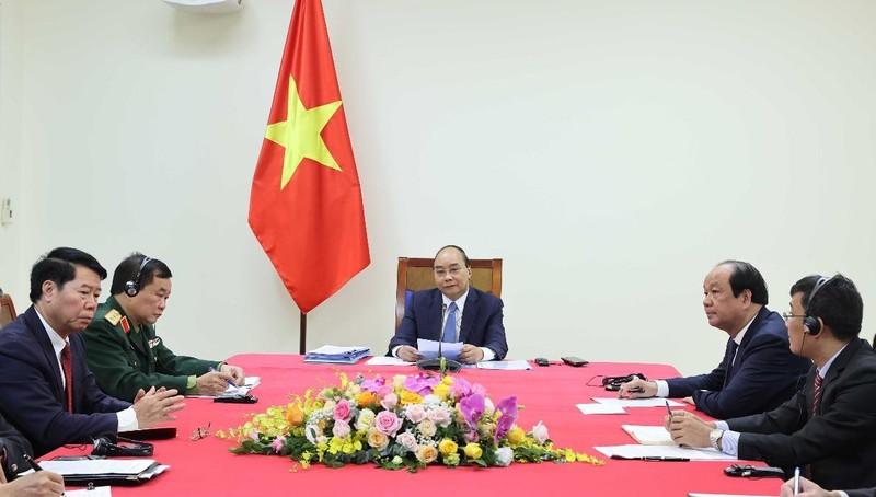 Thủ tướng tại cuộc hội đàm trực tuyến. Ảnh: Phóng viên chuyên trách Thủ tướng của Thông tấn xã Việt Nam.
