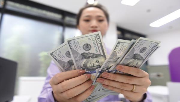 Tỷ giá ngoại tệ ngày 26/2: Tỷ giá trung tâm đi ngang, ngân hàng thương mại tiếp tục giảm