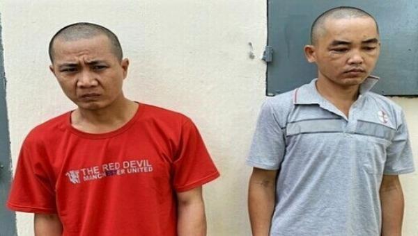 Bị can Võ Văn Khởi (trái) và Dương Điền Trung