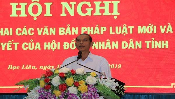 Ông Trần Minh Đức - Phó Giám đốc Sở Tư pháp, Phó Chủ tịch HĐPHPBGDPL tỉnh Bạc Liêu phát biểu tại hội nghị