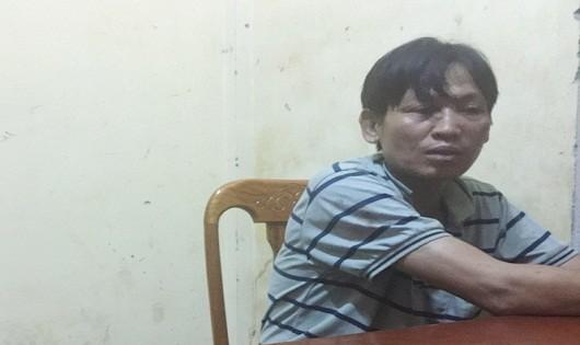 Nguyễn Khắc Thành tại cơ quan điều tra (ảnh Công an cung cấp)